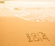 2013 - 2014 written in sand on beach texture