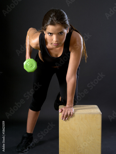 Woman doing tricep extensions