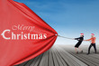 Asian businessteam pull christmas banner