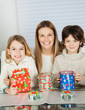 Happy Woman And Children With Christmas Gifts