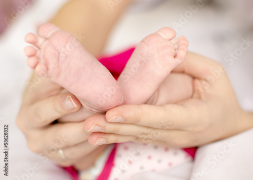 Pediatric holding baby feet