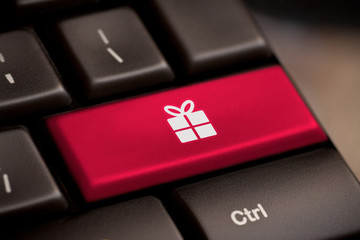 Gift button on keyboard with soft focus