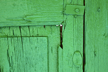piece of colorated green wood as a window