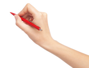 Female hand writing with a red pen