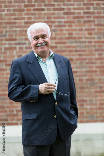 Friendly Senior Adult Looking at You Happily and Confidingly