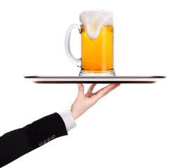 waiter holding silver tray with beer
