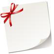 Papier mit roter Schleife