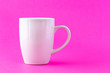 White mug on a pink background