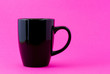 Black mug on a pink background