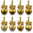 Set of realistic golden christmas balls.