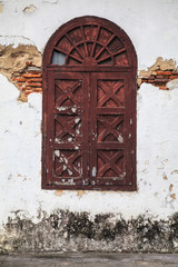 Old wooden arc window