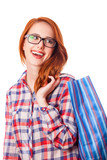 Redhead girl with shopping bag