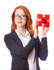 Young business woman happy smile hold gift box in hands.