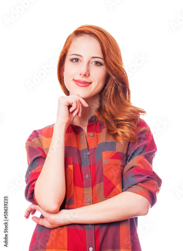 Redhead girl in shirt on white background isolated.