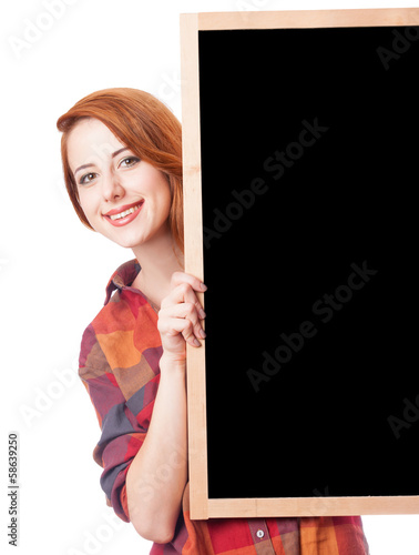 Redhead girl with blackboard