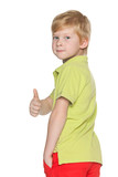 Red-haired young boy with his thumb up