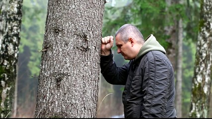 Depressed man leaning on a tree episode 1