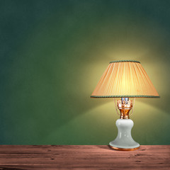 vintage table lamp on green background