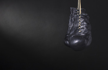 Boxing gloves on a dark background.