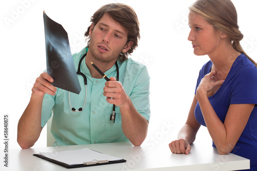 Doctor showing x-ray photo to his patient.
