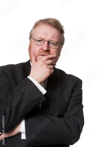 Concerned middle aged man in tuxedo on white