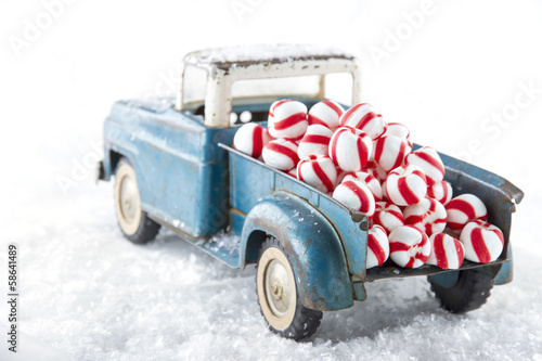 Toy truck carrying striped peppermint candy
