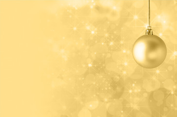 Yellow Christmas Bauble on Starry Bokeh Background