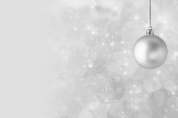 Silver Christmas Bauble on Starry Bokeh Background