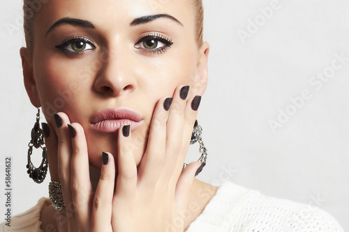 Beautiful woman in woolen dress.accessories.manicure