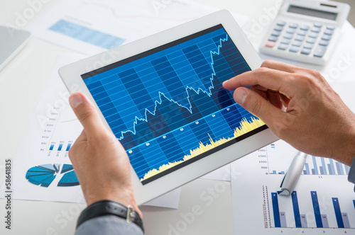 Businessman Analysing Growth With Tablet