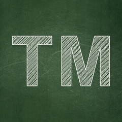 Law concept: Trademark on chalkboard background