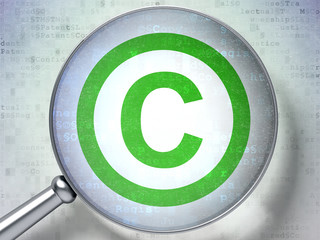 Law concept:  Copyright with optical glass on digital background