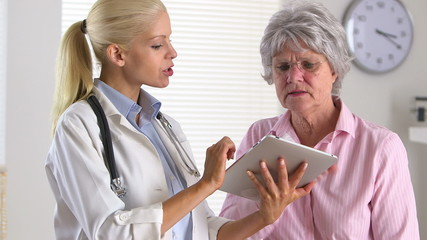 Patient listening to doctor with tablet computer