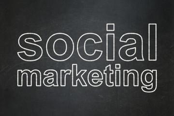 Advertising concept: Social Marketing on chalkboard background