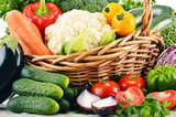 Variety of fresh organic vegetables in wicker basket