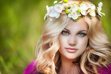 Beautiful healthy woman with natural makeup anf wreath