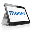 Finance concept: Money on tablet pc computer