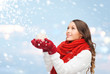 woman in scarf and mittens with christmas ball