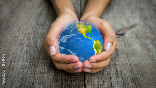Person holding a rotating globe