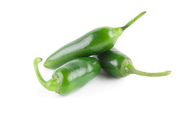 Three green jalapeno peppers isolated on white background