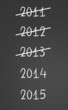 2011, 2012, 2013 crossed and new years 2014, 2015 on chalkboard