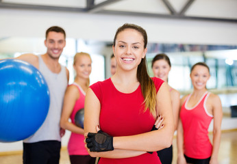 woman standing in front of the group in gym