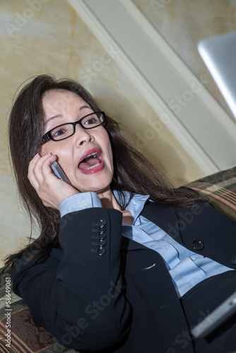 Woman yelling on a phone