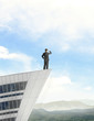 businessman standing on roof