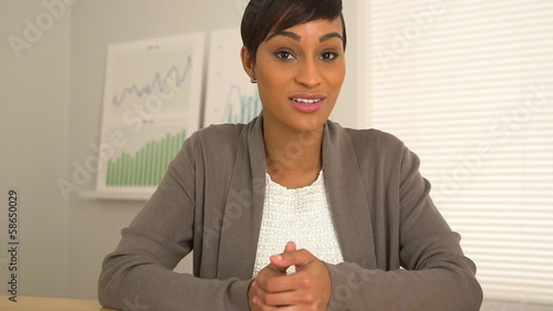 African American business woman talking directly to camera