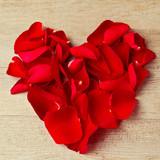 Heart shape made from rose flower petals