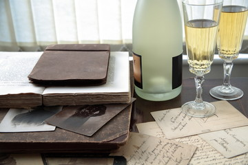 Old books,letters and champagne.