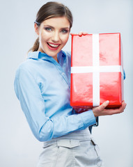 Business woman hold gift box in christmas color style, studio p