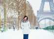 Girl walking in Paris on a winter day