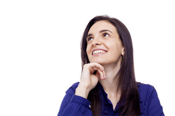 Cheerful young beautiful woman looking up, isolated over a white